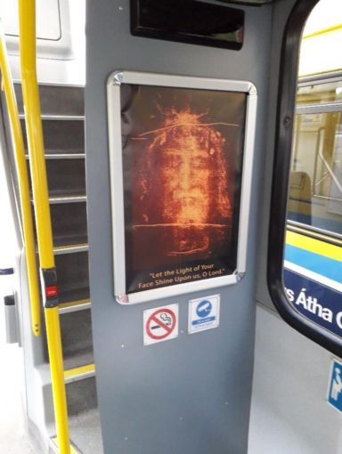 Holy Face displayed on interior of a Dublin bus